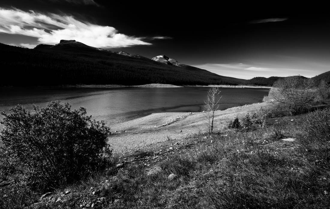 Black and white image of the geologic anomaly that is Medicine Lake, Jasper National Park, Alberta landscape.