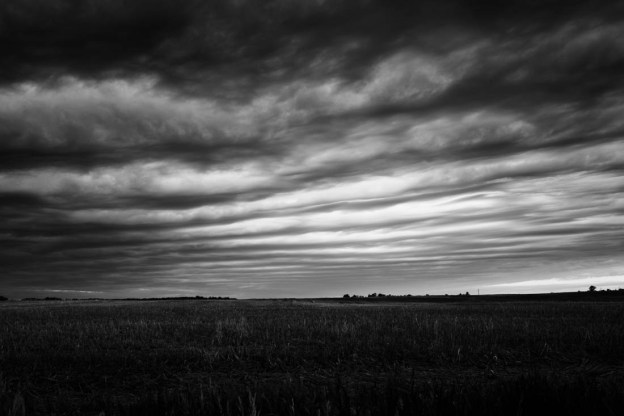 Early stormy skies on the Alberta prairies during late spring, Alberta landscape, using Fuji X-T1 and 23mm ƒ1.4 lens.