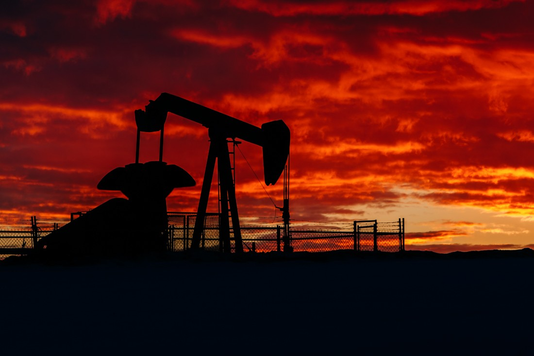 Working pumpjack in rural Alberta during a mid-winter sunrise, Alberta Oil and Gas. No. 1784.