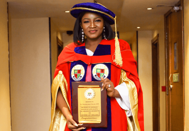 Omotola Jalade-Ekeinde is a doctor...of arts from Igbinedion University