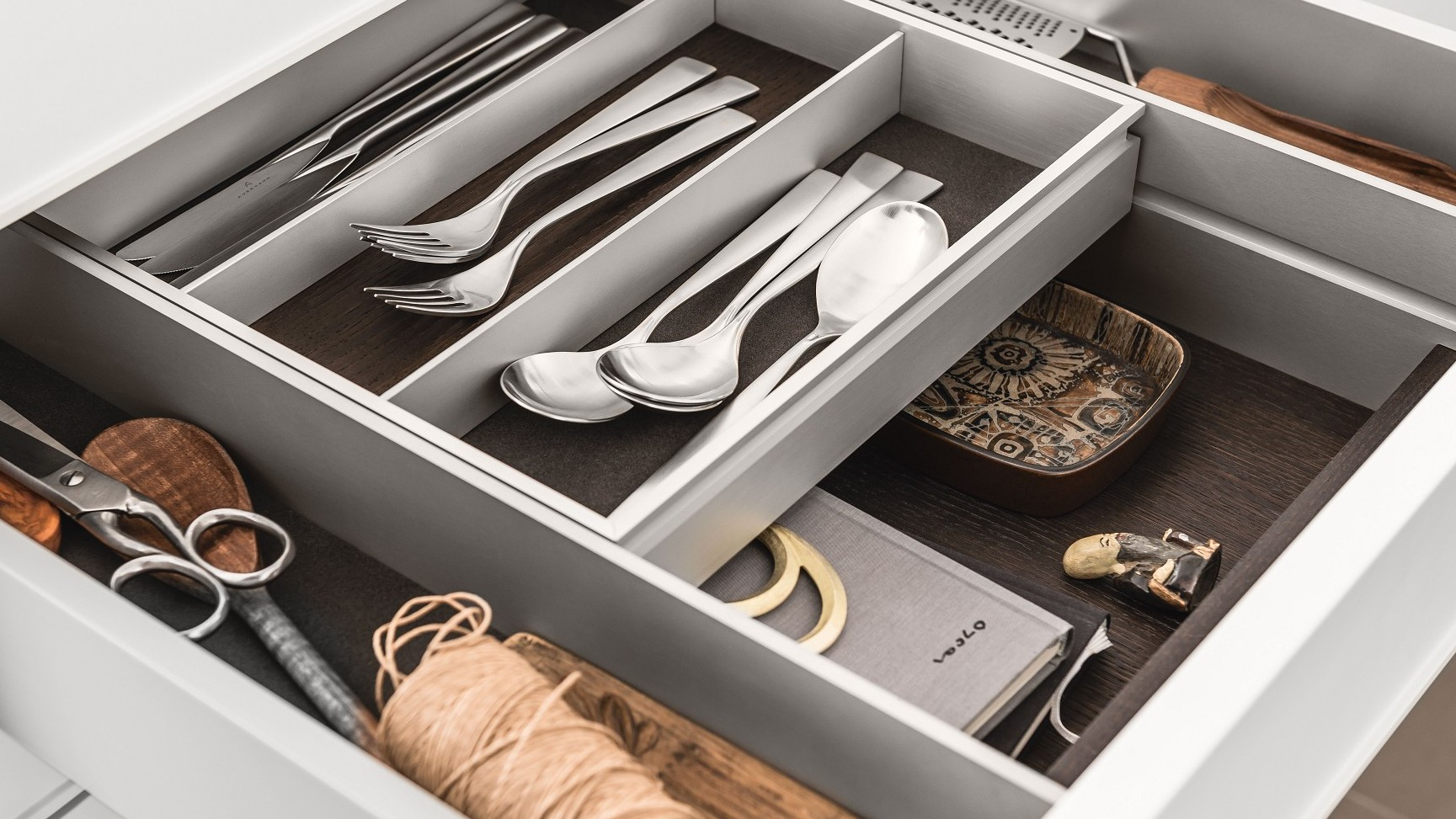 kitchen drawer kohler faucets parts interior accessories by siematic individual innovative a bi level elegantly doubles storage space in drawers and pull