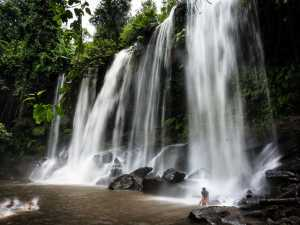 swimming in the large waterfall at Kulen Mountain