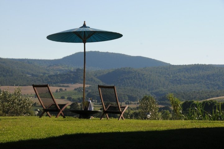 Image of two deck chairs on the SW lawn at SIena House B&B in Tuscany it's a spot that we refer to as 'the beach'