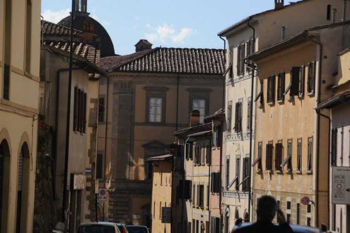 image showing rich ochre walls and shuttered windows and red terracotta roofs in arezzo tuscany