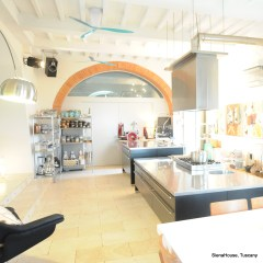 Image of the kitchen on the ground floor showing the semi professional sushi bar style work tops