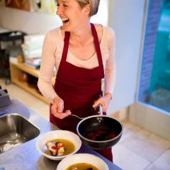 Amanda Helen Atkins cooking saffron in the kitchen at Siena House
