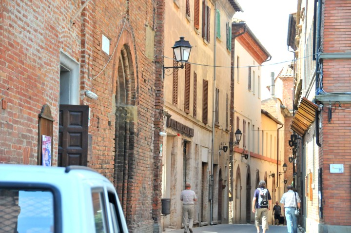 Image showing a lovely tuscan hill town with red and golden streets iron lamps flags arches