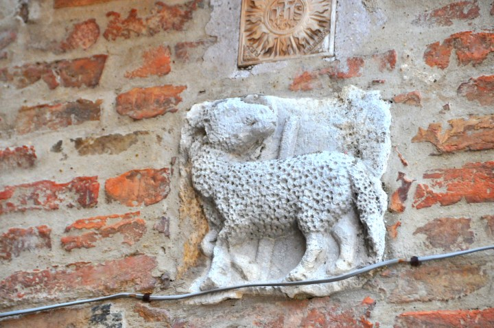 Image showing Etruscan looking carved sheep insignia in a tuscan hill town wall in Valdichiana