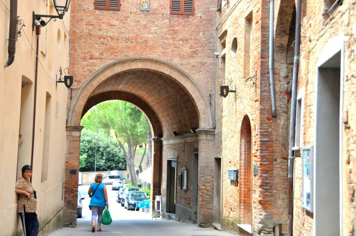 Image of the view through the city gate of a medieval hill town in tuscany