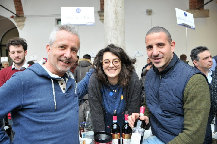 Image showing Sebastian Nasello winemaker of Podere Le Ripi with Martina sommellier and Malvin Tyler of Siena House Tuscany at the 2018 Benvenuto Brunello tasting event