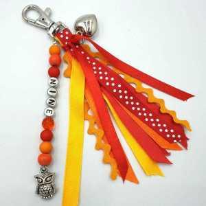Sleutelhanger Sade oranje rood