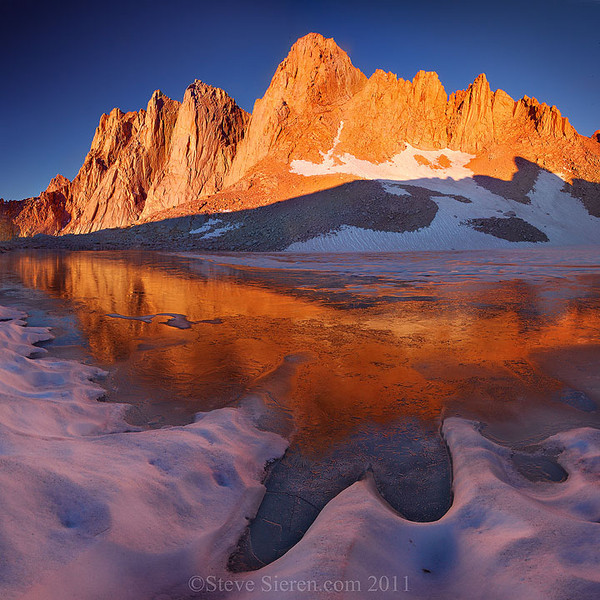 Icey reflection of Mt. Whitney covered in alpen glow in the high country of the Eastern Sierra
