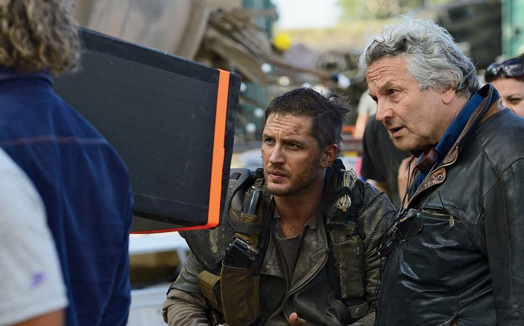 George Miller directs on the set of Mad Max: Fury Road.