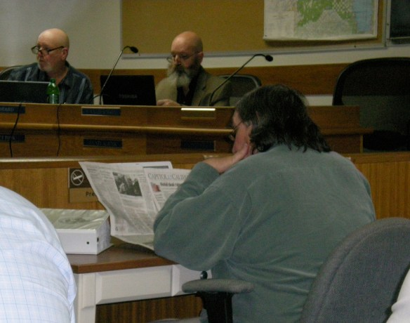 Editor Don Russell gathers news at the Board of Supervisors meeting in Downieville. Supervisor Jim Beard and Auditor/Treasurer/Tax Collector/Risk Manager Van Maddox pretend to be working also.