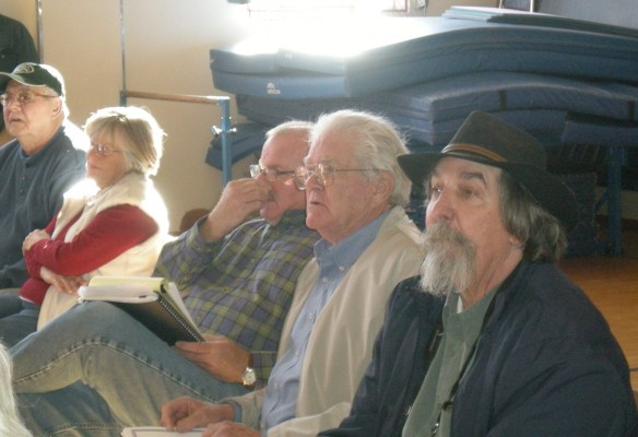 Tim Beals, Tim Holabird and Don Russell listen alertly
