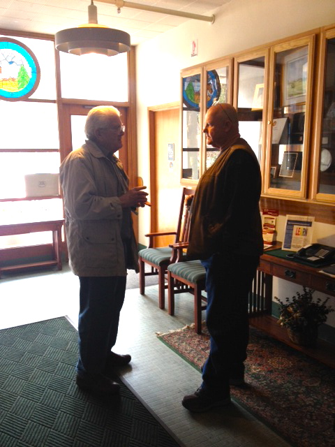 Tim Holabird and Don Yegge confer in the lobby of the Courthouse after meeting with the Supervisors