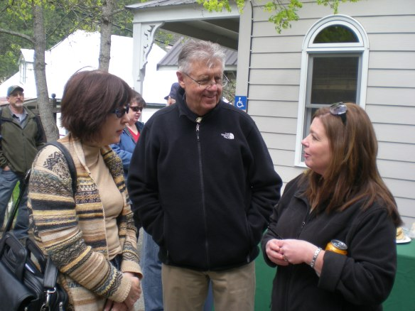 Janice Maddox and Frank Lang converse with new FNP Sarah Cantrell at WSMC BBQ