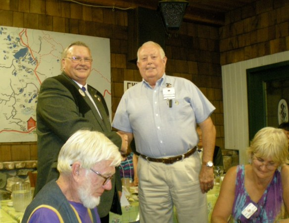 District Governor Andy Anderson gives Downieville Lion Mike Galan special recognition for heading the Windsock Project for medical aircraft.