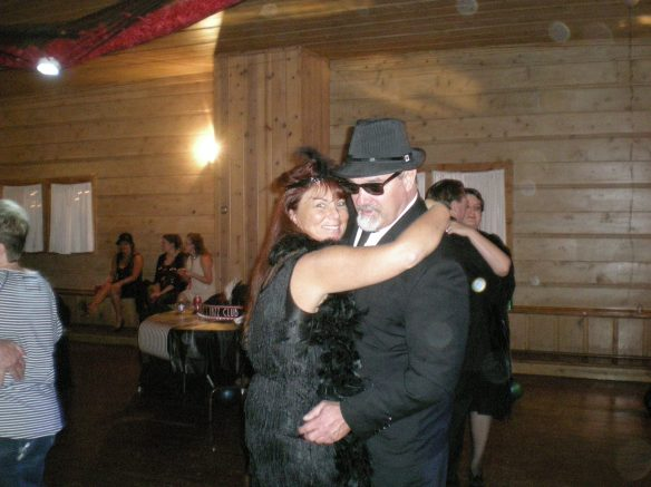 A gangster and his moll at the dance having fun