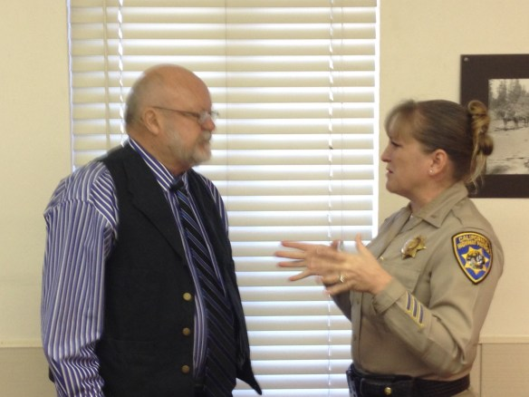 Quincy CHP Lt. Sarah Richards talks to Supervisor Peter Huebner regarding exactly how fast his Jeep should travel.
