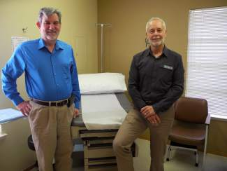 Dr. Peter Van Houten, Sierra Family Medical Clinic's founder and medical director, left, and Steve Weber, the clinic's chief executive officer, inside the Sierra Family Medical Clinic's new facility in Oregon House.