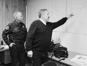 Special investigator Mike Gamberg, right, and Sheriff Greg Hagwood refer to the Keddie murders timeline during a March 1 interview at the sheriff's office in Quincy. Photo by Dan McDonald