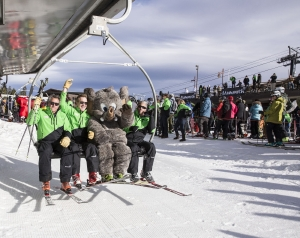 (second from left) MMSA CEO Rusty Gregory, seated next to Woolly, opens the mountain.