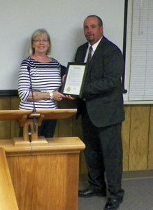 Wild Iris Executive Director Lisa Reel receives Domestic Violence Proclamation from Bishop Mayor Jim Ellis.