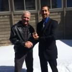 Left, Ted Schade, Retired Air Pollution Control Officer, Right, Phill Kiddoo, Air Pollution Control Officer. Image: Exchanging of the badge, courtesy GBUAPCD.