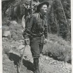 Norman Clyde with his trademark campaign hat, ice axe, pistol and back-breaking pack. Photo courtesy the Eastern California Museum.