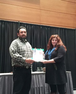 Ron Napoles receives the award from Brianna Candelaria, BLM National Lead for Interpretation