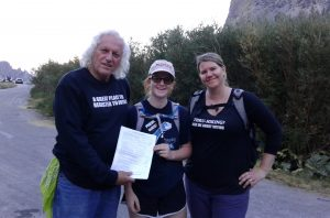First time voter, Amelia Tracy, of Orange County CA registers to vote with Kammi Foote and Chuck Levin at the Kearsarge Pass trailhead at the end of a 10-hour day hike.