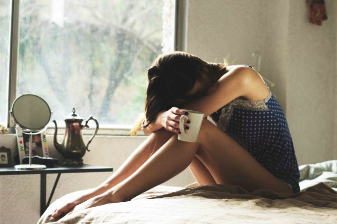 exhausted woman drinking coffee