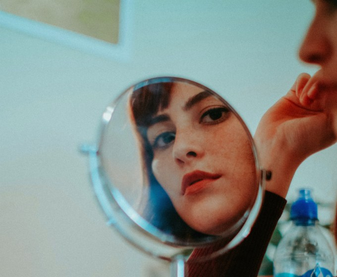 woman looking into a mirror