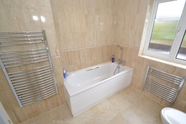 Fitted Bathroom with knock through in Banstead - 6