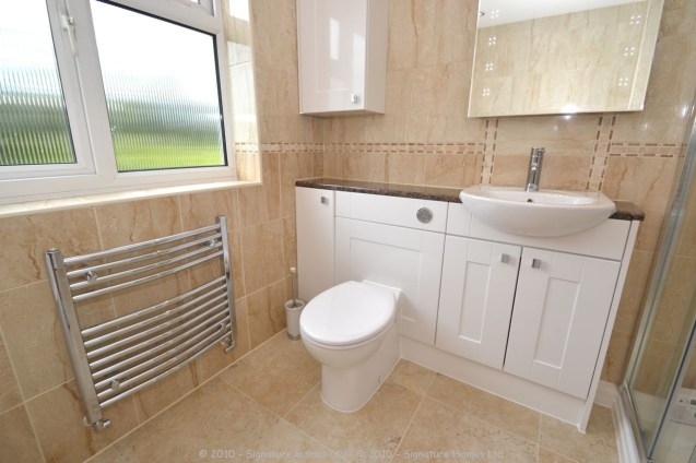 Fitted Bathroom with knock through in Banstead - 5