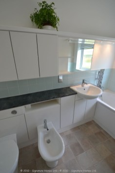 Light & Spacious Fitted Bathroom with pentagon shower enclosure - Woodcrest Road Purley 6