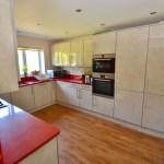 Zurfiz Limestone Kitchen with Quartz Compac Rubi Worktop