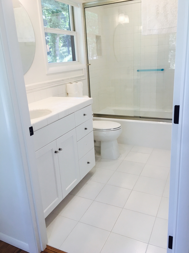 vanities in white subway tile with rope