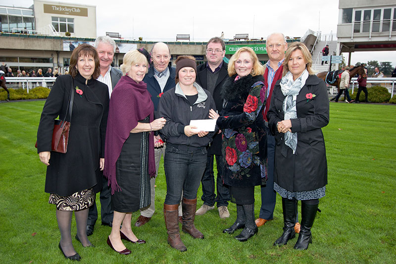 Sign 2000's Murray Crompton, Neil Scott and Steve Spackman and their wives celebrating the company's 25th anniversary at Sandown Park with Employee of the Month Irene Pearson and her husband who are presenting an award to a winning stable girl