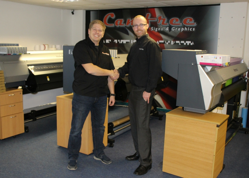 Stafford Cox, Atlantic Service Director hands over the two Ricoh Pro L4130 & Pro 4160 Printers following installation to Camfree Signs & Graphics, MD James Freeman