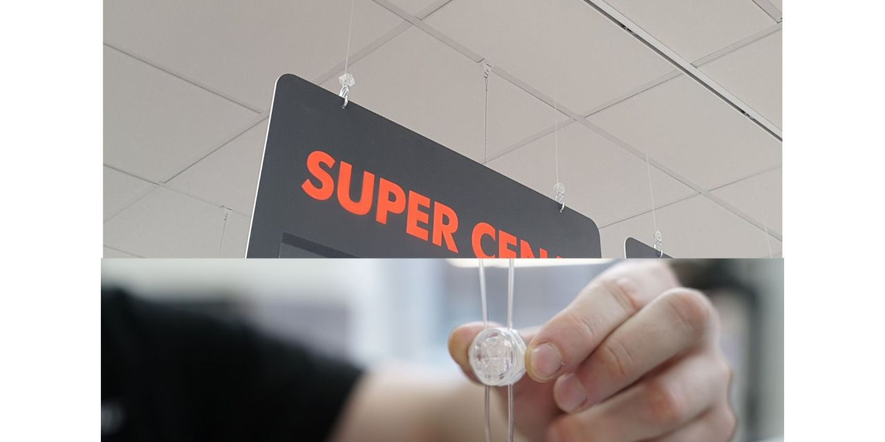 Translucent hanging solution 'grips' sign industry