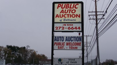 Public Auto Auction pylon sign