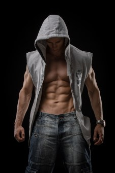 Muscular man in sleeveless hoodie