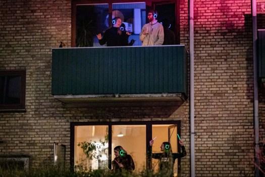 Social distanced neighbors enjoying a silent disco during covid 19