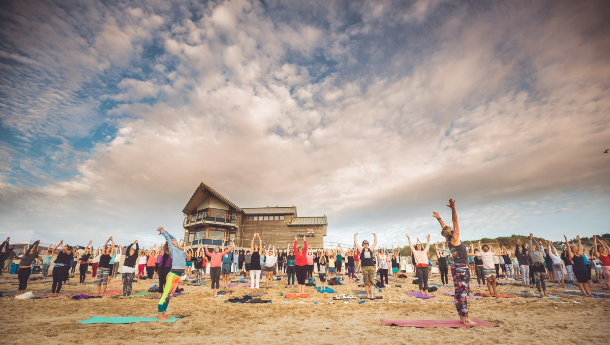 Silent Disco Yoga on Fistral Beach in Newquay cornwall england uk