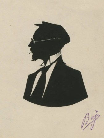 Man with cloth cap and spectables facing left