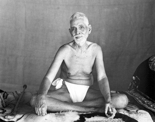 Ramana Maharshi sitting in the Old Hall at Sri Ramanasramam