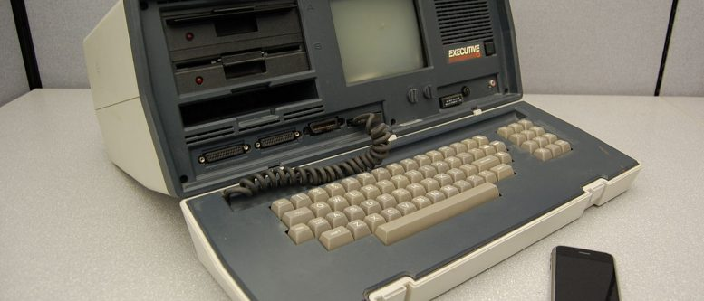 An Osborne Executive portable computer, from 1982, with a Zilog Z80 4 MHz CPU, and a 2007 Apple iPhone with a 412 MHz ARM11 CPU; the Executive weighs 100 times as much, has nearly 500 times the volume, costs approximately 10 times as much (adjusted for inflation), and has about 1/100th the clock frequency of the smartphone.