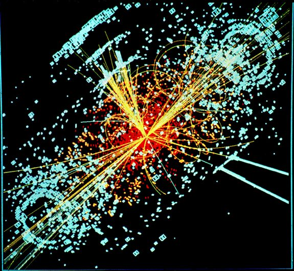 Simulated data modeled for the CMS particle detector on the Large Hadron Collider (LHC) at CERN. Here, following a collision of two protons, a Higgs boson is produced which decays into two jets of hadrons and two electrons. The lines represent the possible paths of particles produced by the proton-proton collision in the detector while the energy these particles deposit is shown in blue.